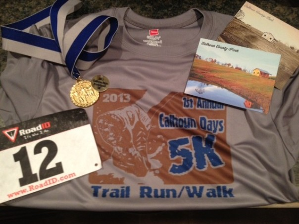 The race T-shirt, souvenir chit, metal, bib and some post cards of the beautiful park.